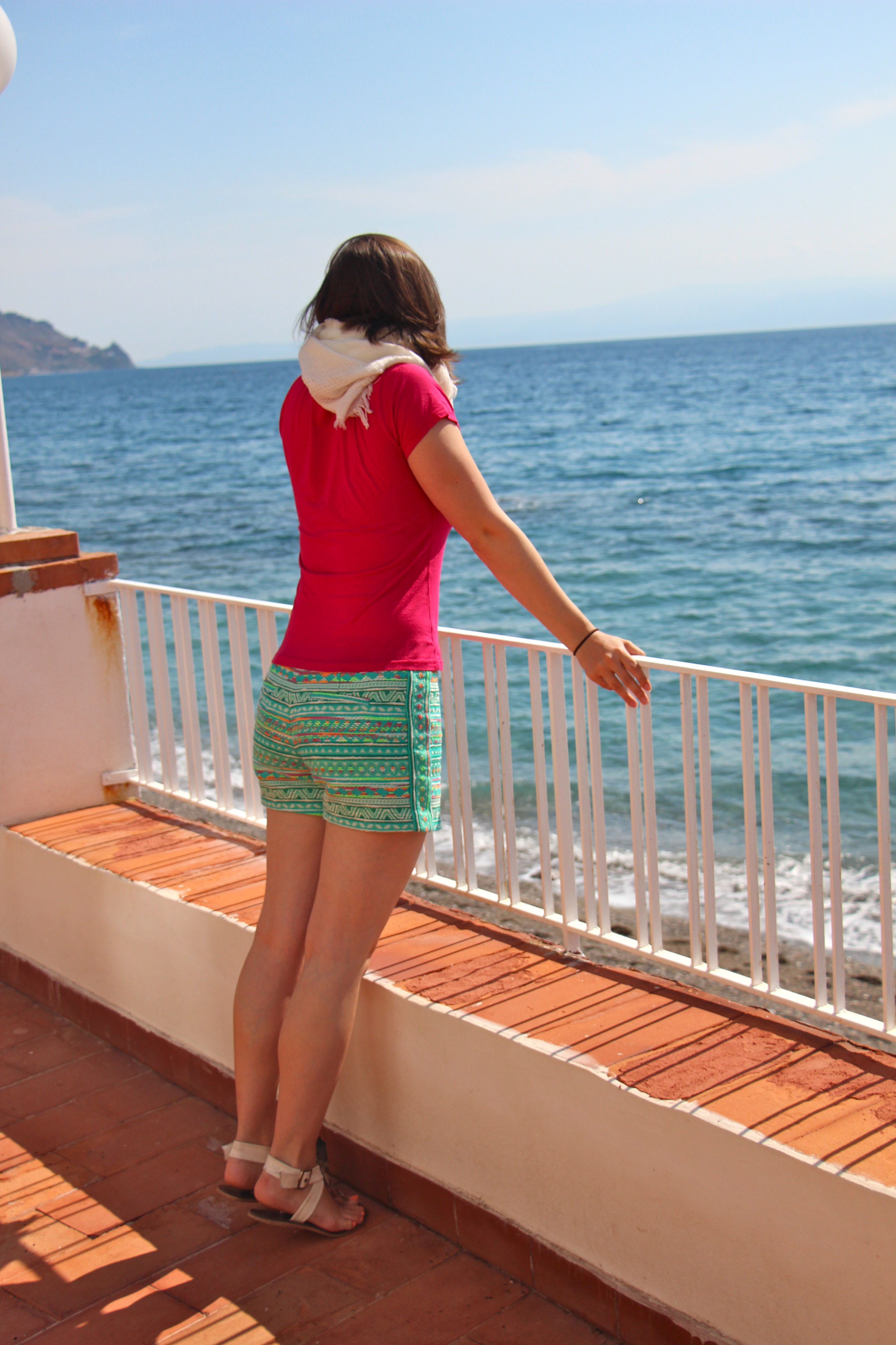 Young Woman Looking at Ocean in Sicily