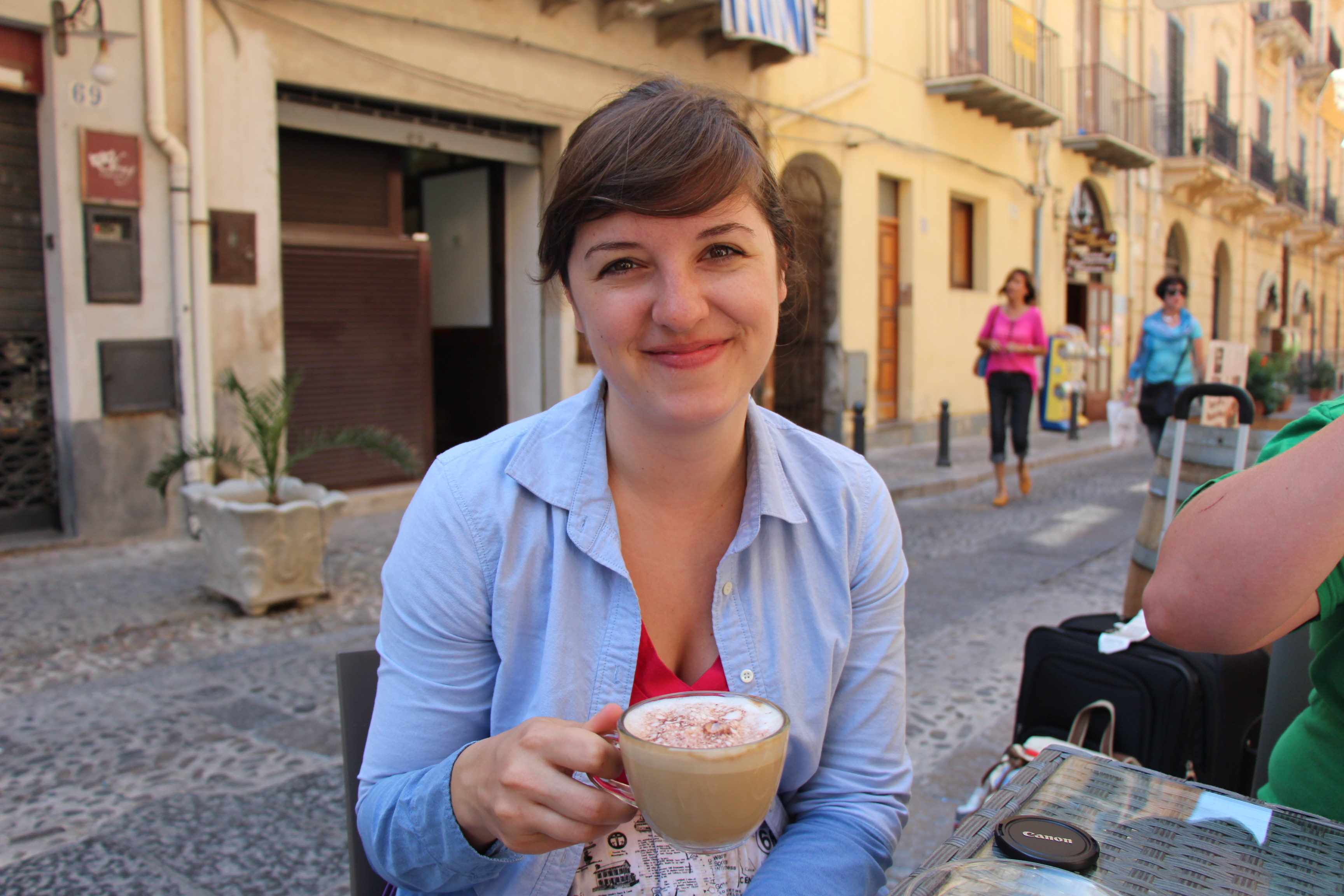 Young Woman Drinking Coffee in Sicily