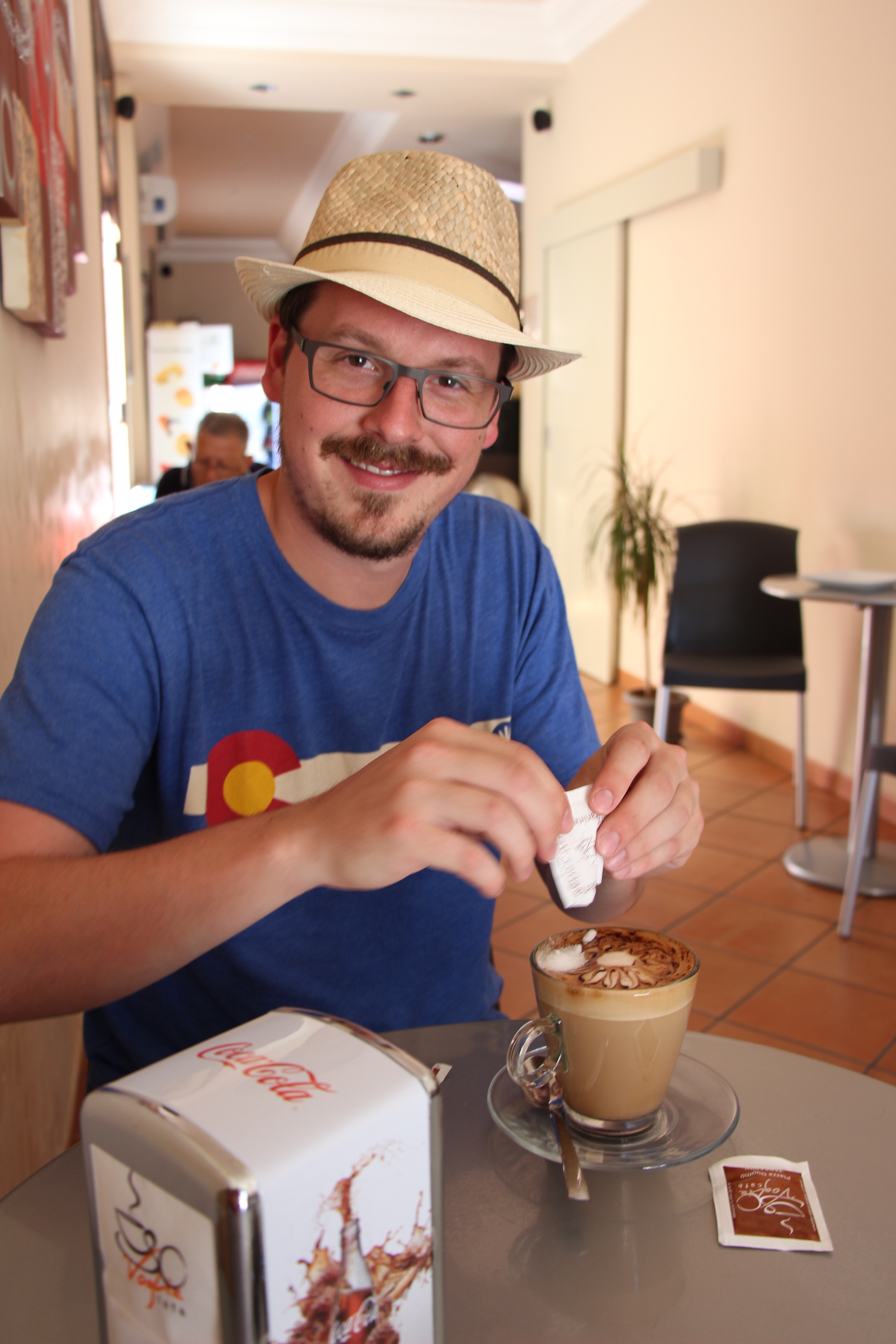 Young Man Drinking Coffee in Sicily