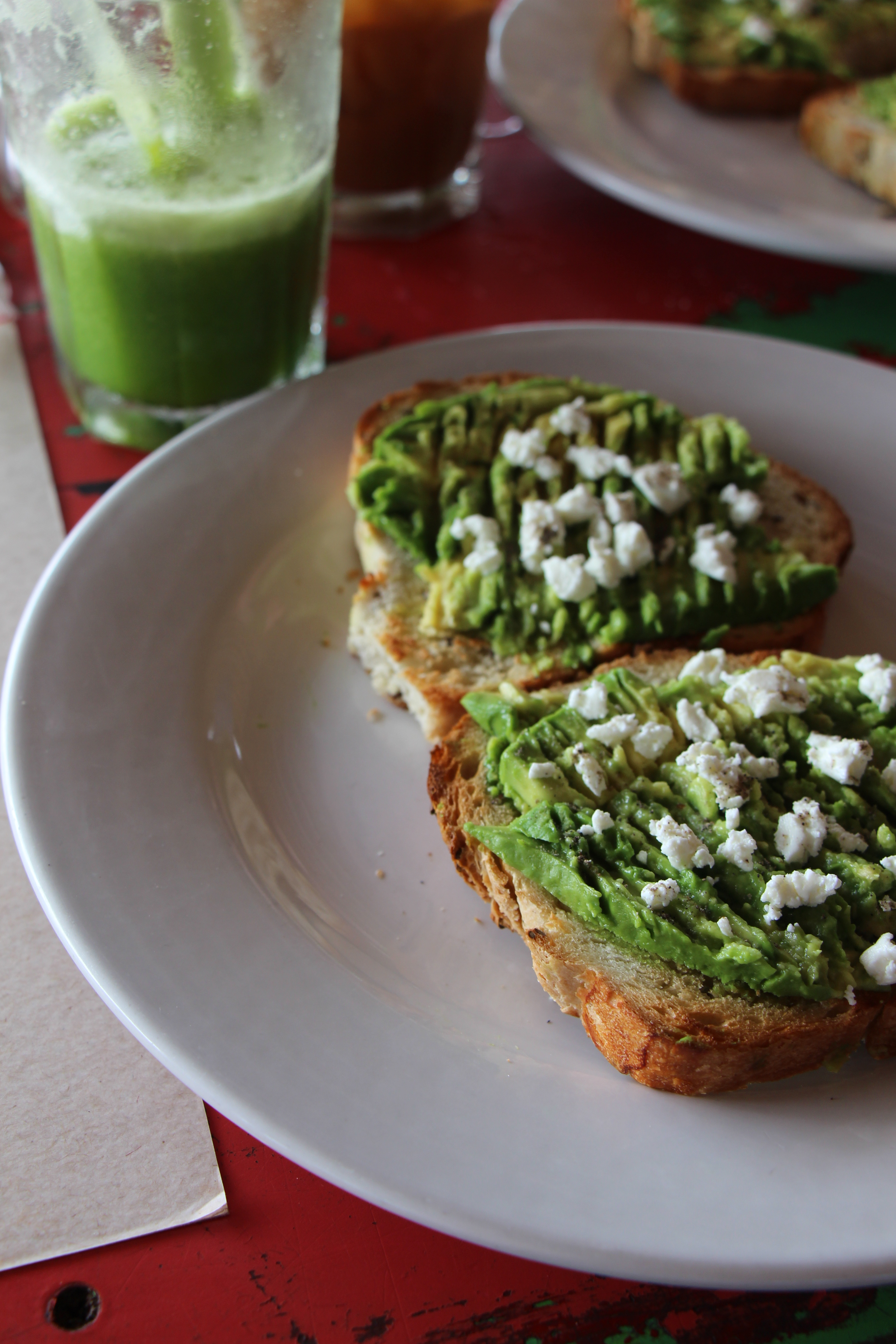 Avocado Toast on Red Table