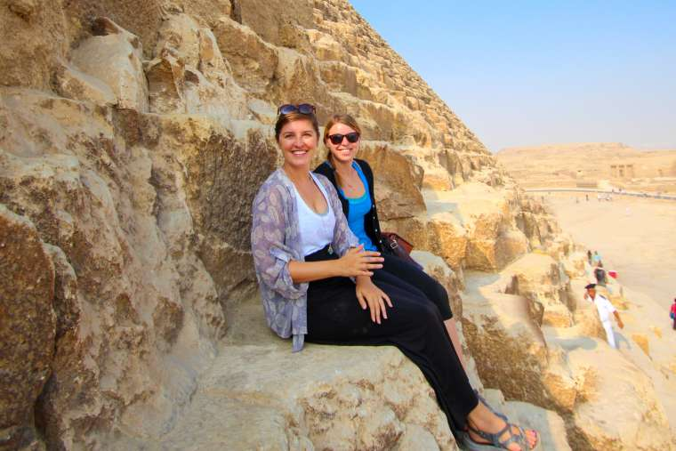 Two Women Sitting on Pyramids of Giza Egypt