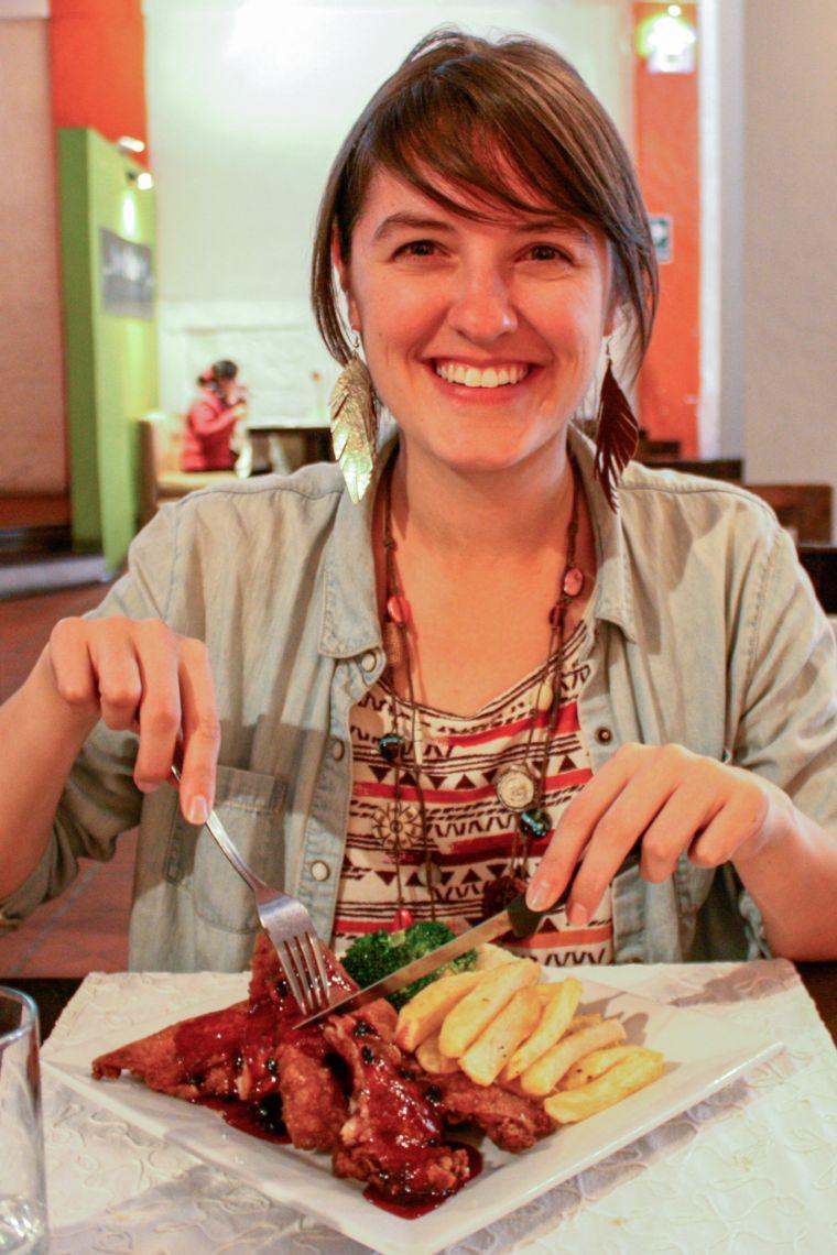 Young Woman Eating Guinea Pig Arequipa Peru